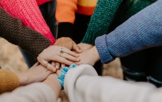 Many Hands - Photo by Hannah Busing on Unsplash